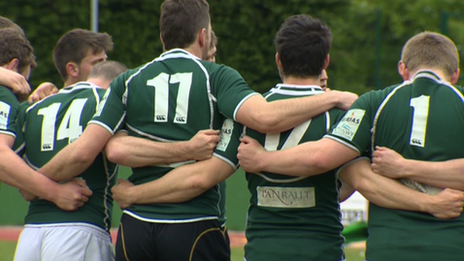 RGC 1404 squad members in a huddle