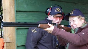 WI member Chrissy Price from Slimbridge WI holding a shotgun