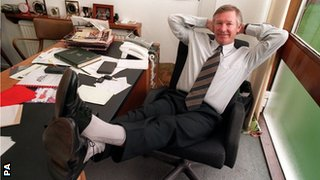 Sir Alex Ferguson at his desk
