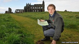Josh Turner, English Heritage steward, at the site of Whitby Abbey