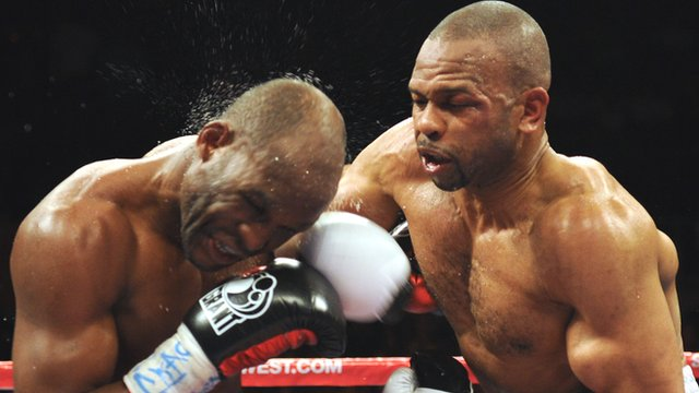 Bernard Hopkin is punched by Roy Jones Jr during their 2010 fight