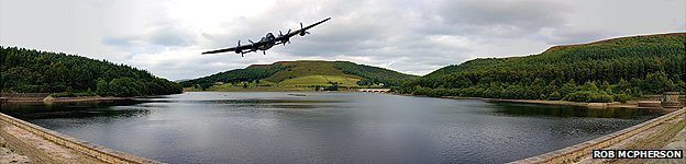 Lancaster Bomber in a memorial run over Ladybower reservoir