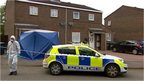 Police carry out investigations at the property in Herald Way, Bicester