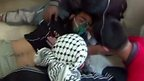 A still from amateur footage shows a man treated by doctors in Saraqeb, Syria, where it is alleged canisters containing poisonous gas were dropped