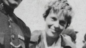Amelia Earhart escorted through crowds of well wishers by an RUC officer, Derry 1932