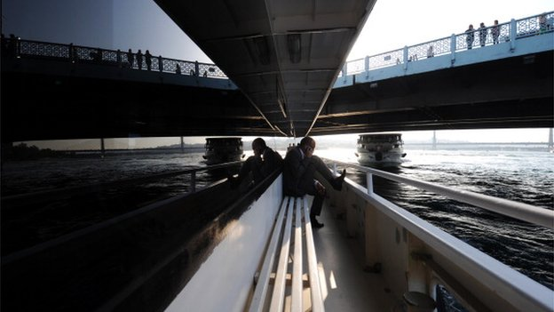 Businessman travels across Bosporus river