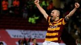 Bradford captain Gary Jones celebrates victory over Arsenal