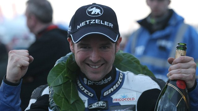 Alastair Seeley celebrates after his Superstock victory which brought up his haul of North West 200 wins to 10
