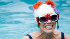 Woman in floral swimming cap