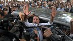 Bollywood star Sanjay Dutt gestures to the media as he arrives at a court in Mumbai, India