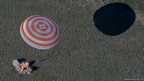 A Russian Soyuz space capsule lands south-east of Dzhezkazgan in Kazakhstan