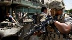 A US soldier arrives at the scene of a suicide car bomber in Kabul, Afghanistan