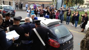 Giuseppe Pesce getting into a police car