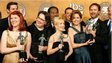 Cast members from the American cast of  The Office pose with awards given by the Screen Actors Guild