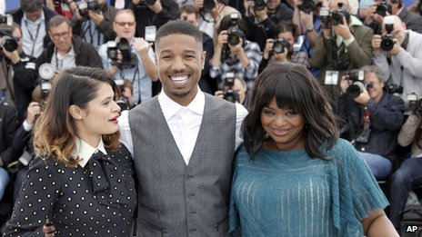 Melonie Diaz, Michael Jordan and Octavia Spencer pose for photographers in Cannes, France, 16 May 2013
