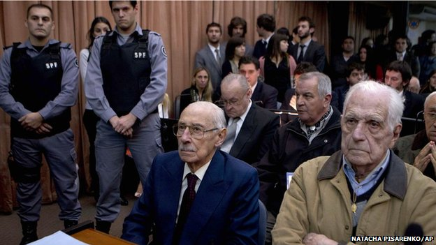 Former dictators Jorge Rafael Videla, second from right, and Reynaldo Bignone, right, wait to listen the verdict of Argentina's historic stolen babies trial in Buenos Aires, Argentina, Thursday, July 5, 2012. (AP Photo/Natacha Pisarenko)