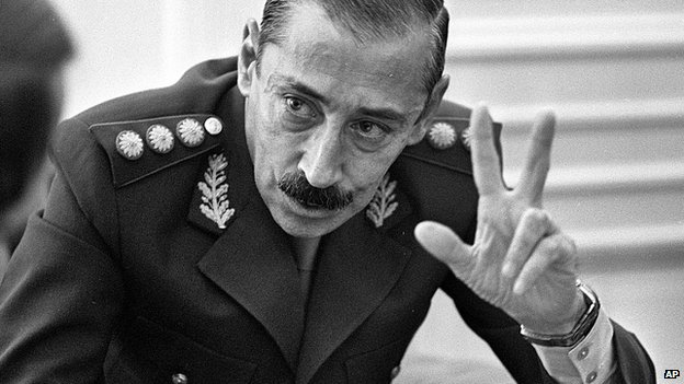 Jorge Rafael Videla talks to journalists at the Buenos Aires Government Palace in 1978