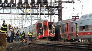 Emergency workers arrive the scene of a train collision in Fairfield, Connecticut, on 17 May 2013