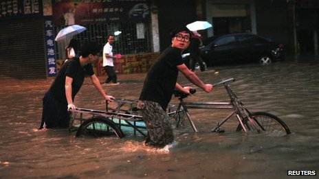 Deadly floods sweep southern China...