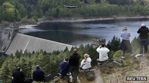 photographers on dam bank