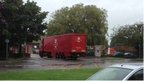 A Royal Mail lorry drives into the Gloucester mail centre site
