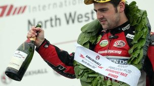 Michael Dunlop celebrates his Supersport win
