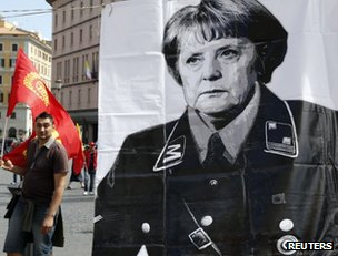 A controversial poster of German Chancellor Angela Merkel could be seen at the rally