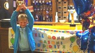 Mason Gotts with trophy