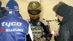 Lincolnshire rider Guy Martin waits as the rain forces a delay to Saturday's schedule