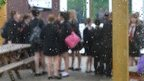 Generic image of pupils seen through a school window