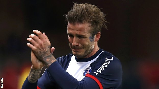 Tearful Beckham signs off with win...