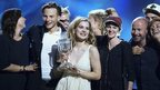Emmelie de Forest (centre) of Denmark holds her trophy after she won the 2013 Eurovision Song Contest in Malmo on 18 May