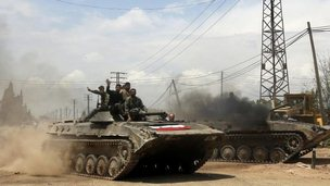 Syrian government forces celebrate as they retake village of Western Dumayna, near Qusair (13 May)