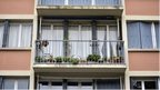 The balcony of the flat where the bodies of two children, aged 5 and 10, were discovered.