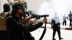 Police officer fires tear gas in Kairouan, Tunisia, on 19 May 2013