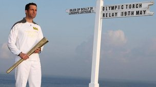 Ben Ainslie with torch at Land's End