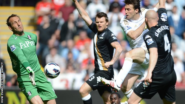 Swansea's Michu is denied by Mark Schwarzer