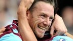 West Ham United&#039;s Kevin Nolan (left) is congratulated by his team-mate after opening the scoring 