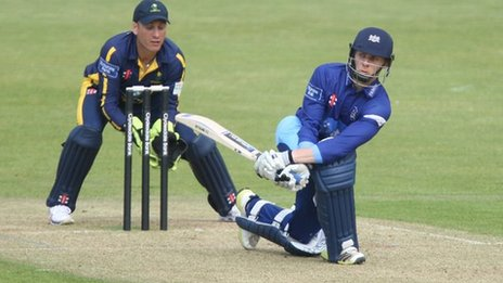 Glamorgan's Mark Wallace keeps wicket to Chris Dent of Gloucestershire