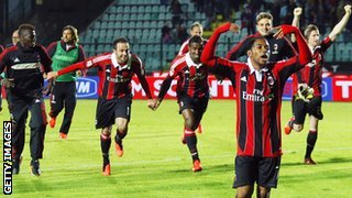 Milan's relieved players celebrate at full-time