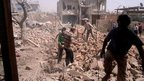 Fierce battle for key Syrian town