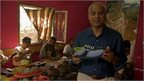 George Alagiah in shoe factory