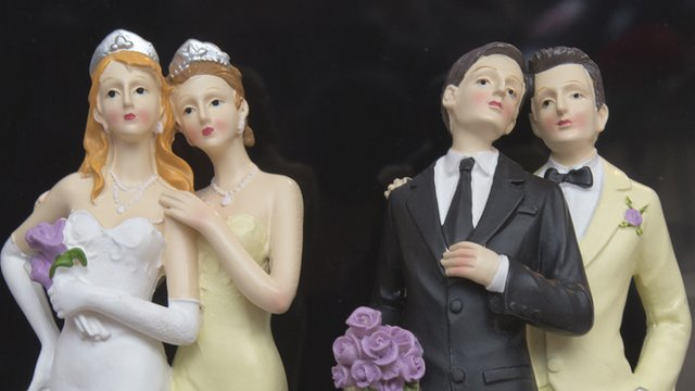 Plastic figurines depicting a female couple and a male couple