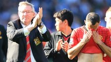 Manchester United manager Sir Alex Ferguson and players
