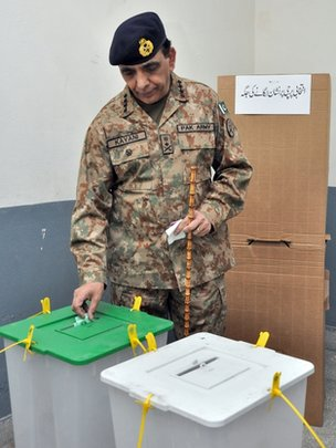 "This handout photograph released by the Pakistan""s Inter Services Public Relations (ISPR) on May 11, 2013 shows Pakistan""s army chief General Ashfaq Kayani casting his vote at a polling station in Rawalpindi"