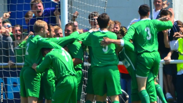 Guernsey celebrate Craig Young's opening goal