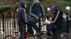 Young people on bikes at a playground
