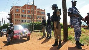 Policemen stand guard outside the Daily Monitor newspaper&#039;s offices in Kampala, Uganda, on 20 May 2013