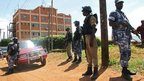 Policemen stand guard outside the Daily Monitor newspaper's offices in Kampala, Uganda, on 20 May 2013