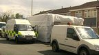 Police at a house in Ellesmere Port